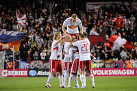New York Red Bulls players including Stephen Keel (22), Luke Rodgers (9), Dane Richards (19), Joel Lindpere (20) and Tim Ream (5) celebrate a goal during a Major League Soccer (MLS) match against the Philadelphia Union at Red Bull Arena in Harrison, NJ, on October 20, 2011.