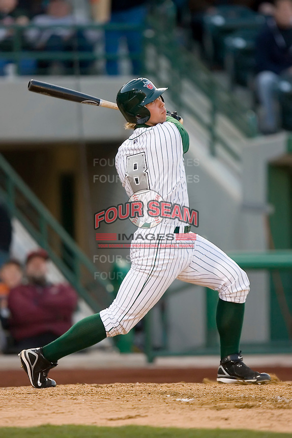 James Darnell #8 of the Fort Wayne Tin Caps follows through on his swing versus the Dayton Dragons at Parkview Field April 16, 2009 in Fort Wayne, Indiana. (Photo by Brian Westerholt / Four Seam Images)