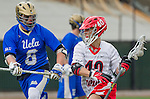 Orange, CA 03-05-17 - Derek Hankim (UCLA #6) and Hunter So (Chapman #40) in action during the UCLA - Champman Southern Lacrosse Conference MCLA Division 1 Men's Lacrosse game.