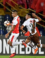 BOGOTA - COLOMBIA - 20 - 02 - 2018: Juan Roa (Izq.) jugador de Independiente Santa Fe disputa el balón con Luis Garcia (Der.) jugador de Santiago Wanderers, durante partido de vuelta entre Independiente Santa Fe (COL) y Santiago Wanderers (CHL), de la fase 3 llave 1, por la Copa Conmebol Libertadores 2018, jugado en el estadio Nemesio Camcho El Campin de la ciudad de Bogota. / Juan Roa (L) player of Independiente Santa Fe vies for the ball with Luis Garcia (R) player of Santiago Wanderers, during a match for the second leg between Independiente Santa Fe (COL) and Santiago Wanderers (CHL), of the 3rd phase key 1, for the Copa Conmebol Libertadores 2018 at the Nemesio Camacho El Campin Stadium in Bogota city. Photo: VizzorImage  / Luis Ramirez / Staff.