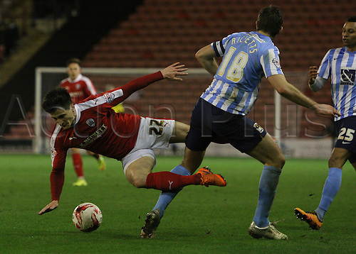 01.03.2016. Oakwell Stadium, Barnsley, England. Skybet League One. Coventrys Sam Ricketts sticks a leg out and brings down Barnsleys George Williams