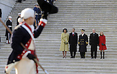 Washington, DC - January 20, 2009 -- United States President Barack Obama, his wife Michelle (L), Vice President Joseph Biden (2-R) and his wife Jill (R) are escorted by Major General Richard Rowe are saluted as they review the Troops from the steps of the U.S Capitol Building after Obama was sworn in as the 44th President of the United States during the 56th Presidential Inauguration ceremony in Washington, D.C., USA 20 January 2009..Credit: Tannen Maury - Pool via CNP