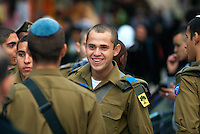 A group of young Israeli soldiers wonder the narrow allies of the Old City of Jerusalem.