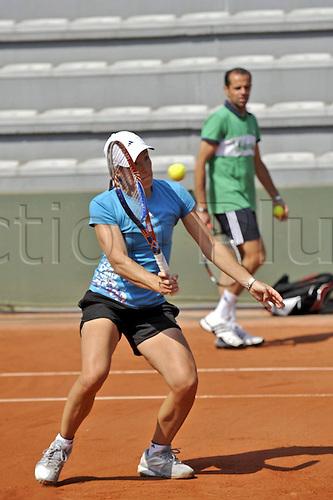 21 05 2010  Justine Henin BEL  Roland Garros International  ladies tournament. WTA Tennis Tour 2010. Henin plays a forehand return under the watchful eye of her trainer