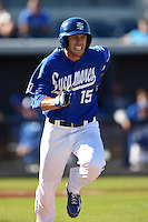 Indiana State Sycamores infielder/outfielder Jacob Hayes (15) runs to first during a game against the Vanderbilt Commodores on February 21, 2015 at Charlotte Sports Park in Port Charlotte, Florida.  Indiana State defeated Vanderbilt 8-1.  (Mike Janes/Four Seam Images)