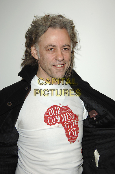"Sir BOB GELDOF.At Press Launch for  Penguin published book ""Our Common Interest, The Comission for Africa: An Arguement"".(Bob is co-founder of LiveAid) .Penguin, 80 Strand, .London 9 June 2005.half length t-shirt logo red white t shirt.Ref: PL.www.capitalpictures.com.sales@capitalpictures.com.© Phil Loftus/Capital Pictures."