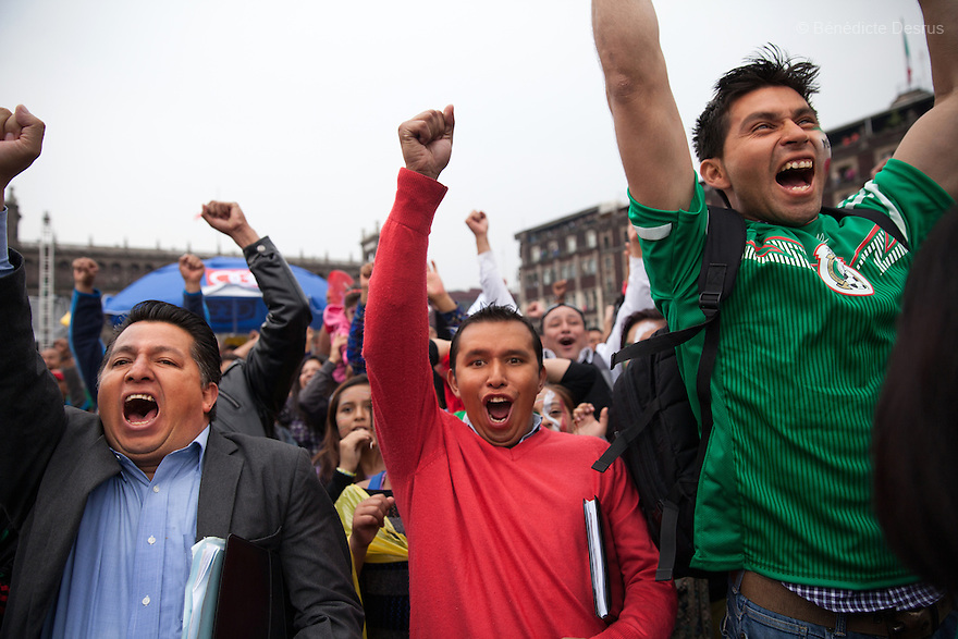 Mexico's fans celebrate. Thousands of fans gather to watch the transmission of the 2014 World Cup soccer match between Croatia and Mexico at the Zocalo main square in Mexico City on June 23, 2014. Mexico qualify from Group A with three late goals against Croatia. (Photo by Bénédicte Desrus)