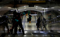 BOGOTA, COLOMBIA - APRIL 19: Workers clean and disinfect a Transmilenio bus station as a preventive measure against COVID-19, in Bogota on April 19, 2020. The COVID-19 pandemic has spread in Colombia, infecting 3621 people and claiming 166 deaths. (Photo by Leonardo Munoz/VIEWpress)