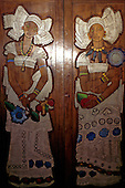 Salvador, Brazil. Representation of two Bahianas dancing in relief on a timber panel by Arentinian artist Carybe; Bahia State.