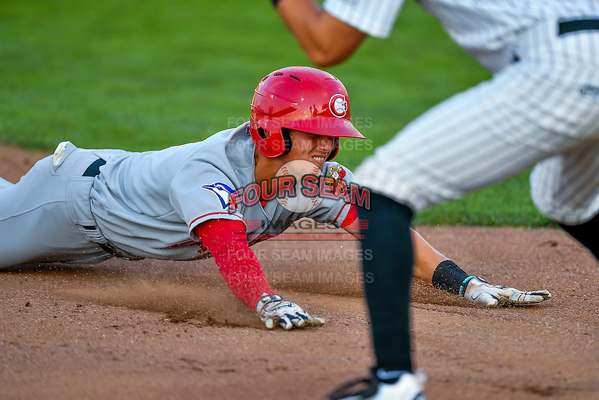 Northwest League All-Star Cavan Biggio (4) of the Vancouver Canadians dives into third base against the Pioneer League All-Stars at the 2nd Annual Northwest League-Pioneer League All-Star Game at Lindquist Field on August 2, 2016 in Ogden, Utah. The Northwest League defeated the Pioneer League 11-5. (Stephen Smith/Four Seam Images)