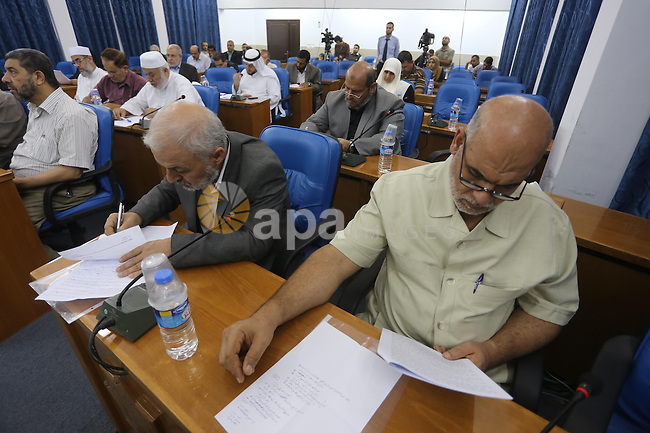 Members of the Palestinian legislative council from Hamas movement attend a meeting at the legislative council in Gaza city on Oct. 14, 2015. Photo by Mohammed Asad