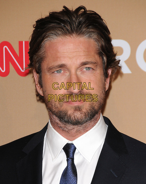 GERARD BUTLER .at The CNN Heroes: An All-star Tribute held at The Shrine Auditorium in Los Angeles, California, USA, .November 20th, 2010..portrait headshot beard facial hair blue tie white shirt .CAP/RKE/DVS.©DVS/RockinExposures/Capital Pictures.