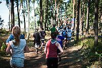 People running in Conquest world at Quest. Photo: Audun Ingebrigtsen / Scouterna