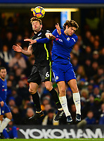 Dale Stephans of Brighton and Marcos Alonso of Chelsea battles for a header during the EPL - Premier League match between Chelsea and Brighton and Hove Albion at Stamford Bridge, London, England on 26 December 2017. Photo by PRiME Media Images.