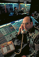 An air traffic controller at the Wright Patterson Airforce Base, Dayton, Ohio. He is talking on the phone in the control room. Air Traffic Controller. Cleveland Ohio USA.