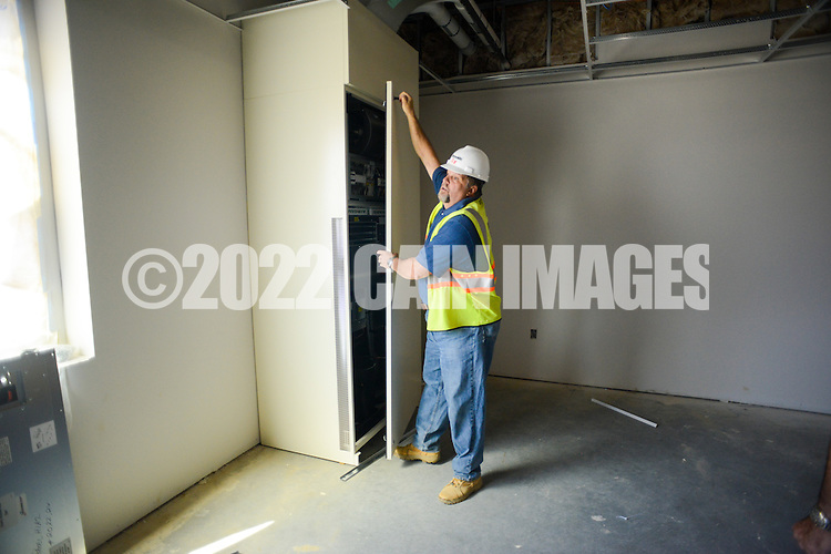 BK Horner, onsite construction manager for Reynolds Construction shows the new heating system in one of the classrooms at the under construction elementary school Wednesday August 5, 2015 in Bristol, Pennsylvania. (Photo by William Thomas Cain/Cain Images)