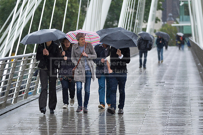 24/09/2012. LONDON, UK. Members of the public attempt to stay dry in central London today (24/09/12). Rain and strong winds today hit the UK causing widespread disruption with gusts of up to 60mph predicted for the north of England and up to 80mm of rain predicted in some areas.. Photo credit: Matt Cetti-Roberts