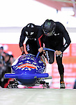 18 December 2010: John Napier starts up his 2-man bobsled for the USA, finishing in 7th place at the Viessmann FIBT World Cup Bobsled Championships on Mount Van Hoevenberg in Lake Placid, New York, USA. Mandatory Credit: Ed Wolfstein Photo