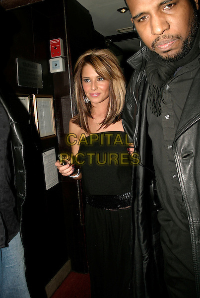 CHERYL TWEEDY - GIRLS ALOUD.Leaving The Embassy Club, London, UK..December 15th, 2005.Ref: AH.half length black strapless top skirt chipped nail polish varnish.www.capitalpictures.com.sales@capitalpictures.com.© Capital Pictures.