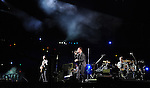PASADENA, CA. - October 25: The Edge, Bono, Larry Mullen, Jr. Adam Clayton of U2 perform in concert during their 360º Tour at the Rose Bowl on October 25, 2009 in Pasadena, California.