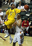 Jefferson's Tyrone Phillips leaps over North Eugene's Joe Kammerer for a layup in the 5A boys state championship at McArthur Court Friday March 13, 2009.
