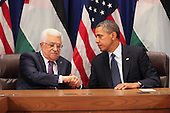 United States President Barack Obama, right, shakes hands with President Mahmoud Abbas of the Palestinian Authority, left, after Obama addressed the 68th United Nations General Assembly in New York, New York on Tuesday, September 24, 2013.<br /> Credit: Allan Tannenbaum / Pool via CNP