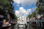 06-07-2016, Amsterdam, Netherlands, Revellers, participants, audience, fans, lookers on, spectators, react on their boats during the annual Canal Parade as part of the Euro Gay Pride week in Amsterdam, the Netherlands, <br /> foto: Michael Kooren/Utrecht