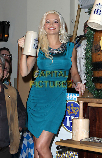 Holly Madison.taps the newest Oktoberfest keg at Hofbrauhaus Las Vegas, USA,.7th October 2011..half length dress beer keg blue teal chain collar  mug tankard .CAP/ADM/MJT.© MJT/AdMedia/Capital Pictures.