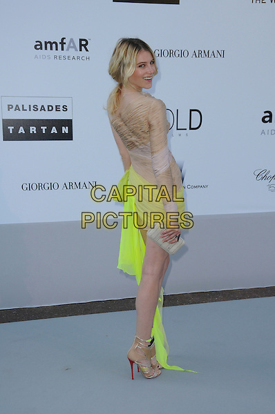 DREE HEMINGWAY.arrivals at amfAR's Cinema Against AIDS 2010 benefit gala at the Hotel du Cap, Antibes, Cannes, France during the Cannes Film Festival.20th May 2010.amfAR full length beige neon yellow dress ruched silk mini sandals one shoulder nude sleeve open toe shoes boots ankle side clutch bag back rear behind .CAP/CAS.©Bob Cass/Capital Pictures.