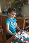 Berkeley CA Girl six-years-old excitedly opening desired Christmas present  MR