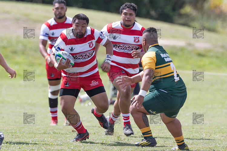 Lepetimalo Lauese makes a run towards David Fuimaono. Counties Manukau Premier Counties Power Club Rugby game between Karaka and Pukekohe, played at the Karaka Sports Park on Saturday March 10th 2018. Pukekohe won the game 31 - 27 after trailing 5 - 20 at halftime.<br /> Photo by Richard Spranger.