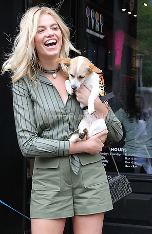NEW YORK, NY - MAY 14:  Model Hailey Clauson, 2016 Sports Illustrated Swimsuit issue cover girl,  at the Dylan's Candy BarN Dog Adoption Event in New York, New York on May 14, 2016.  Photo Credit: Rainmaker Photo/MediaPunch