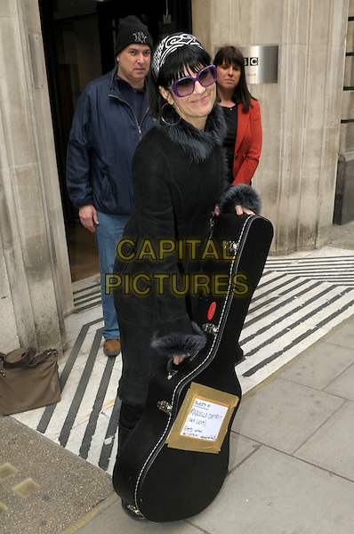 Marcella Detroit .At BBC Radio 2, London, England..29th April 2013.full length black coat jacket sunglasses shades guitar case sign property of aka levy query contact Neil Sheriff hairband white fur trim collar .CAP/IA.©Ian Allis/Capital Pictures.