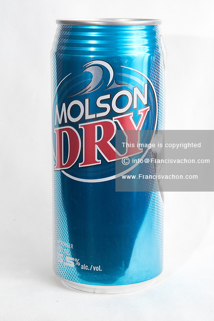 A Molson Dry beer can over a white background