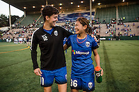 Seattle, Washington - Saturday, July 2nd, 2016: Seattle Reign FC midfielder Keelin Winters (11) and Seattle Reign FC forward Nahomi Kawasumi (36) after a regular season National Women's Soccer League (NWSL) match between the Seattle Reign FC and the Boston Breakers at Memorial Stadium. Seattle won 2-0.