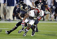 Florida International University football player running back Brandon Bennett (36) plays against Troy University on October 26, 2011 at Miami, Florida. FIU won the game 23-20 in overtime. .