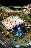 A Charlotte NC winter tradition, the annual WBT Holiday on Ice skating rink, outside the NASCAR Hall of Fame museum. The outdoor ice skating rink in the heart of uptown Charlotte is located at the corner of Martin Luther King MLK Blvd and Brevard.<br /> <br /> Charlotte Photographer - PatrickSchneiderPhoto.com