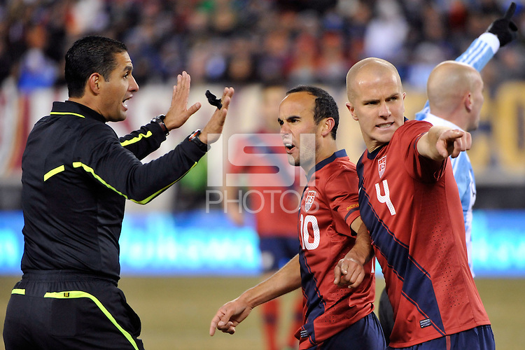Landon Donovan (10) and Michael Bradley (4) of the United States argue a call with referee Roberto Garcia. The United States (USA) and Argentina (ARG) played to a 1-1 tie during an international friendly at the New Meadowlands Stadium in East Rutherford, NJ, on March 26, 2011.