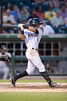 Jacob May (8) of the Charlotte Knights follows through on his swing against the Indianapolis Indians at BB&T BallPark on June 16, 2017 in Charlotte, North Carolina.  The Knights defeated the Indians 12-4.  (Brian Westerholt/Four Seam Images)