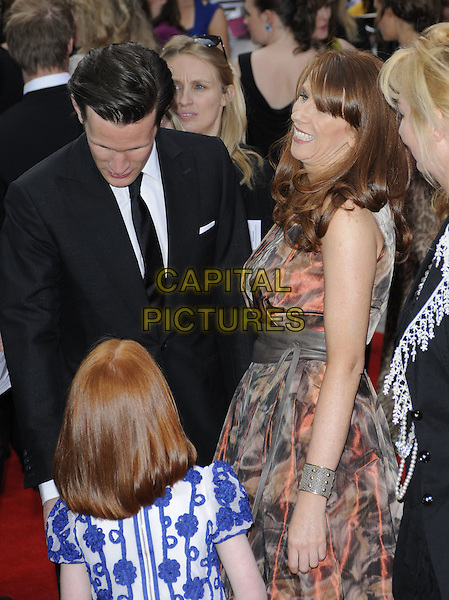"WILLIAM ""BILL"" ROCHE, MATT SMITH & CATHERINE TATE .Attending the Philips British Academy Television Awards, Grosvenor house Hotel, Park Lane, London, England, UK, May 22nd 2011..arrivals TV Baftas Bafta half length black tuxedo tux bow tie suit brown coral pink grey gray print .CAP/CAN.©Can Nguyen/Capital Pictures."