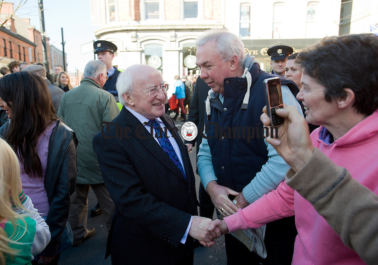President Michael D. Higgins mingles with the public after watching the parade to Cusack Park for the Ireland V Scotland senior hurling shinty International game, to mark the official opening of Fr Mc Namara Memorial Park in Doora. Photograph by John Kelly.