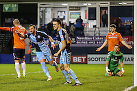 Paul Hayes of Wycombe Wanderers (2nd left) celebrates scoring his team's second goal against Luton Town to make it 0-2 during the Sky Bet League 2 match between Luton Town and Wycombe Wanderers at Kenilworth Road, Luton, England on 26 December 2015. Photo by David Horn.
