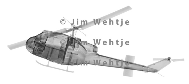 X-ray image of a UH-1 Huey helicopter (black on white) by Jim Wehtje, specialist in x-ray art and design images.