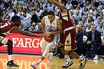 30 January 2016: North Carolina's Marcus Paige is defended by Boston College's Eli Carter (3) and Sammy Barnes-Thompkins (55). The University of North Carolina Tar Heels hosted the Boston College Eagles at the Dean E. Smith Center in Chapel Hill, North Carolina in a 2015-16 NCAA Division I Men's Basketball game. UNC won the game 89-62.