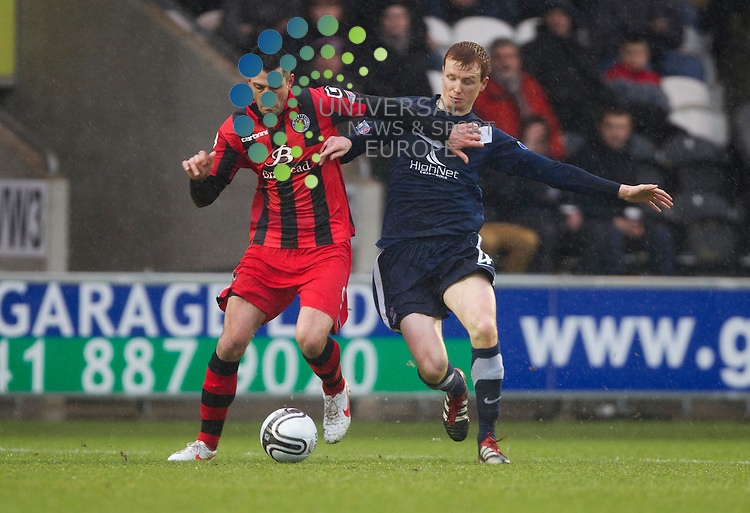 Stephen Thompson takes on Scott Boyd of Ross during the St Mirren v Ross County William Hill Scottish Cup round Five..Picture: Maurice McDonald/Universal News And Sport (Scotland). 4 February 2012. www.unpixs.com.