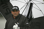 Angel Cabrera takes shelter from the rain as he waits to tee off on the 1st hole to start his first round of the Smurfit Kappa European Open at The K Club, Strffan,Co.Kildare, Ireland 5th July 2007 (Photo by Eoin Clarke/NEWSFILE)