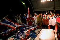 "The bodies of two ""Red Shirt"" protesters are displayed on the stage erected at the Phan Fah bridge in central Bangkok. They were allegedly kille by the military who opened fire before retreating."