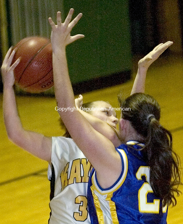 WATERBURY, CT. 21 December 2006--122106SV13--#30  Vanessa Stanislawski of Kaynor Tech. tries to pass around  #23 Lacey DePolico of Norwich Tech. during basketball action in Waterbury Thursday.<br /> Steven Valenti Republican-American