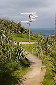 World sign post on the Cape Foulwind walkway, Westport, Buller district, West Coast, South Island, New Zealand.