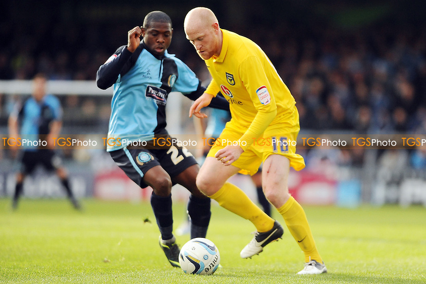 Jo Osei Kuffour of Wycombe Wanderers  and Andrew Whing of Oxford - Wycombe Wanderers vs Oxford United - NPower League Two Football at Adams Park, High Wycombe - 27/10/12 - MANDATORY CREDIT: Anne-Marie Sanderson/TGSPHOTO - Self billing applies where appropriate - 0845 094 6026 - contact@tgsphoto.co.uk - NO UNPAID USE.